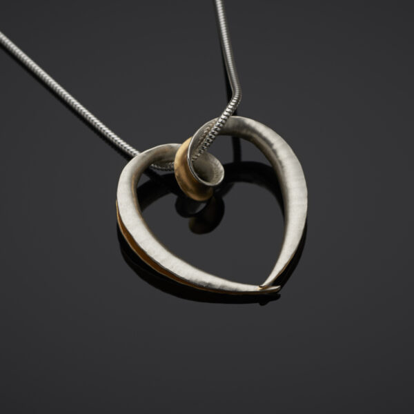 Anticlastic heart pendant gold plated on inside surface