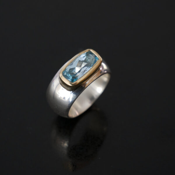 Chunky silver and gold ring with cushion topaz